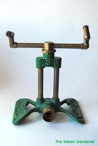 Vintage green sprinkler